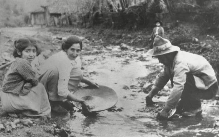 1933 - (Original Caption) Panning For Gold to Solve the Depression! Andacollo, Chile: These Chileans are panning for gold in the neighborhood of the sacred village of Andacollo, near the port of Coquimbo, searching for the gold which the governmnet says will rescue the country from its economic depression. One hundred-thousand jobless, with their families, have been set to work throughout Chile, searching for gold in the scores of streams that flow down to the sea from the snow-clad Andean mountains.