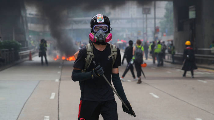 Mandatory Credit: Photo by FAZRY ISMAIL/EPA-EFE/Shutterstock (10429552v) An anti-government protester holds a baton during a Global Anti Totalitarianism Rally in Hong Kong, China, 29 September 2019. Hong Kong has entered its fourth month of mass protests, originally triggered by a now suspended extradition bill to mainland China, that have turned into a wider pro-democracy movement. Global anti-totalitarianism march in Hong Kong, China - 29 Sep 2019