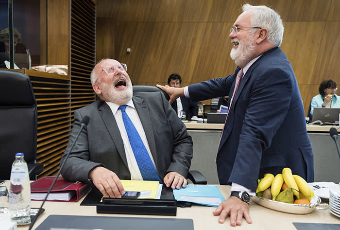EU Commission First vice-president Frans Timmermans, left, smiles as he talks with European Commissioner for Climate Action & Energy Miguel Arias Canete during a meeting of the college of commissioners at EU headquarters in Brussels on Wednesday, May 23, 2018. (AP Photo/Geert Vanden Wijngaert)