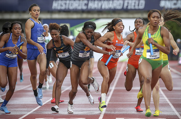 Southern California's Kendall Ellis, center left, and Florida's Taylor Sharpe collide on the anchor lap of the women's 1,600 relay on the final day of the NCAA Outdoor Track and Field Championships at Hayward Field on Saturday, June 9, 2018, in Eugene, Ore. Southern California won the race. (Collin Andrew/The Register-Guard via AP)