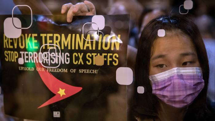 """HONG KONG, CHINA - AUGUST 28: Protesters stick posters and notes on the outside of the Cathay Pacific offices during a rally against White terror and the dismissal of Cathay Pacific staff on August 28, 2019 in Hong Kong, China. Pro-democracy protesters have continued demonstrations across Hong Kong since 9 June against a controversial bill which allows extraditions to mainland China as the ongoing protests surpassed the Umbrella Movement five years ago, becoming the biggest political crisis since Britain handed its onetime colony back to China in 1997. Hong Kong's embattled leader Carrie Lam apologized for introducing the bill and declared it """"dead"""", however the campaign continues to draw large crowds to voice their discontent while many end up in violent clashes with the police as protesters show no signs of stopping. (Photo by Chris McGrath/Getty Images)"""