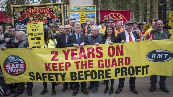 The RMT holds a protest outside parliament to argue the case for keeping guards on trains. To go with Josh Spero copy. Picture shows: RMT General Secretary, Mick Cash, joining protesters outside parliament.