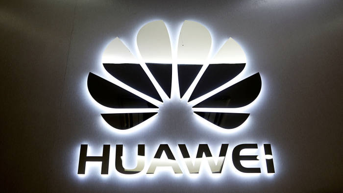 FILE PHOTO: The logo of Huawei is pictured at a mobile phone shop in Singapore, May 21, 2019. REUTERS/Edgar Su/File Photo