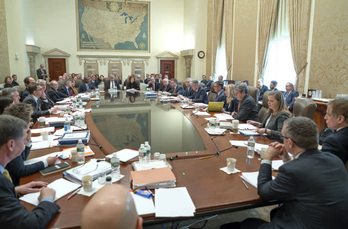Federal Open Market Committee (FOMC) participants gather at the Marriner S. Eccles Building in Washington, D.C., for a two-day meeting held on January 29-30, 2019. Please note: Confidential documents seen in this photo have been obscured.
