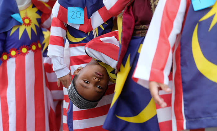 Children from a nursery wear clothes in the colours of the national flag of Malaysia during the pre-celebrations of the Malaysian national day in Kuantan, Malaysia, 06 August 2018. The Hari Merdeka (Independence Day) or the Hari Kebangsaan (National day) is taking place on 31 August to mark the day when the Malaysia gained independence from the British Empire in 1957. Photo: Mohd Faizol Aziz/BERNAMA/dpa