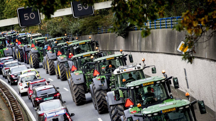 Farmers drive their tractors in a line in The Hague on October 16, 2019 during a protest against the nitrogen policy rules. (Photo by Koen van Weel / ANP / AFP) / Netherlands OUT (Photo by KOEN VAN WEEL/ANP/AFP via Getty Images)