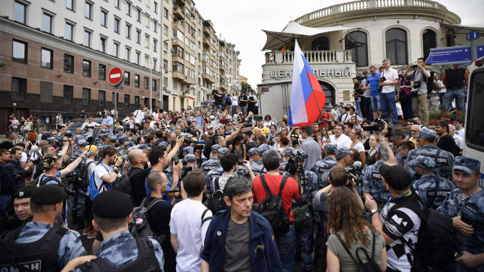 "Protesters gather as they take part in a march to protest against the alleged impunity of law enforcement agencies in central Moscow on June 12, 2019. - More than 200 people including opposition leader Alexei Navalny were detained as police sought to break up a peaceful Moscow rally against the alleged impunity of law enforcement agencies. Russian police in riot gear moved in against the unsanctioned march of more 1,000 people amid screams of protesters shouting ""you are criminals"" and ""stop police terror."" (Photo by Alexander NEMENOV / AFP)ALEXANDER NEMENOV/AFP/Getty Images"