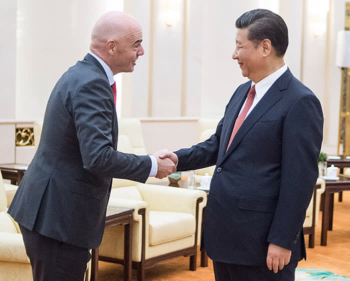 China's President Xi Jinping (R) shakes hands with FIFA President Gianni Infantino at the Great Hall of the People in Beijing on June 14, 2017. Chinese President Xi Jinping met with FIFA chief Gianni Infantino on June 14 as the football world watches for signs that the Asian giant will make a bid to host a World Cup. / AFP PHOTO / POOL / Fred DUFOUR (Photo credit should read FRED DUFOUR/AFP/Getty Images)
