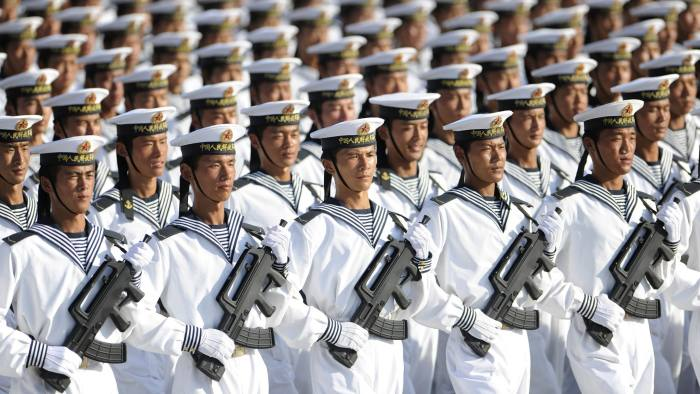Members of the Chinese People's Liberation Army (PLA) Navy march in formation during a training session at the 60th National Day Parade Village on the outskirts of Beijing September 15, 2009. China will celebrate the 60th anniversary of its founding on October 1. Picture taken September 15, 2009. REUTERS/Joe Chan (CHINA ANNIVERSARY MILITARY POLITICS) CHINA OUT. NO COMMERCIAL OR EDITORIAL SALES IN CHINA - RTXP10F