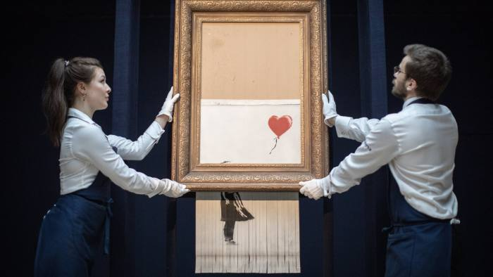 """11/10/2018. Sotheby's display """"Love is in the Bin"""" the artwork created when Banksy's """"Girl with Balloon"""" shredded itself after being bought at auction."""