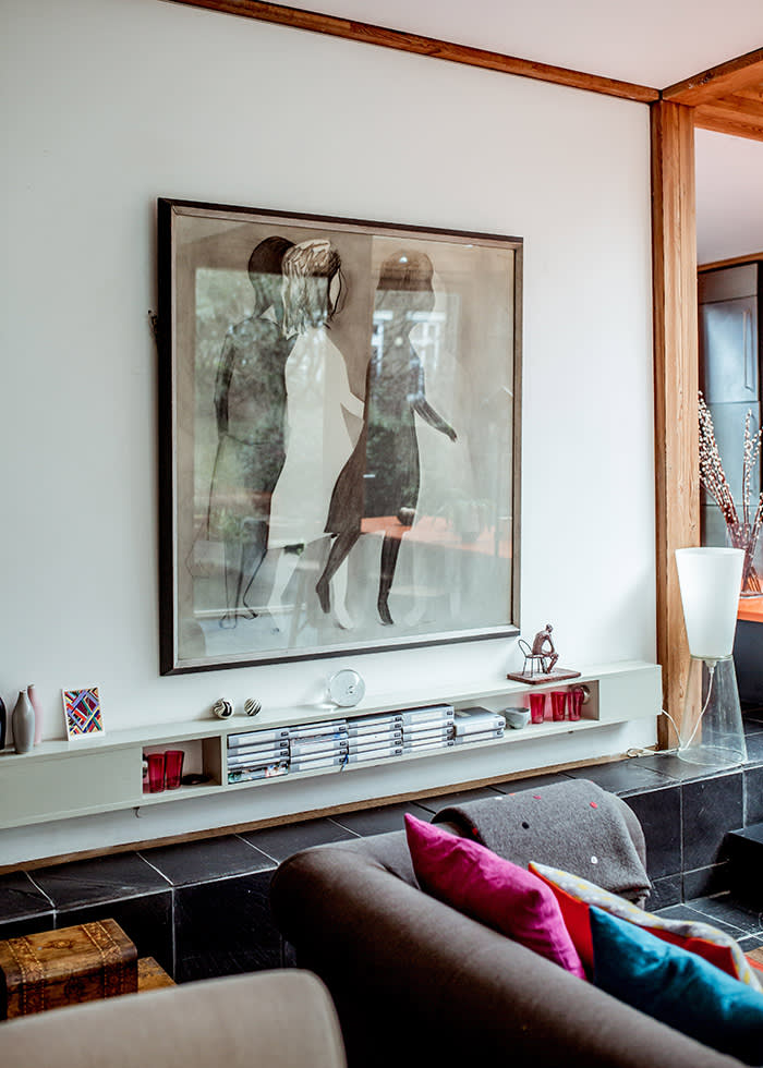 LUCY KELLAWAY shot at her modernist home in Hackney Artwork in the open living area. PHOTOGRAPHER: SOPHIA SPRING