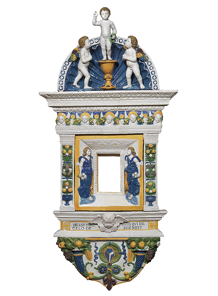GIOVANNI Della ROBBIA (Florence, 1469–1529/30) Eucharistic Tabernacle with Jesus as a Child blessing, Angels and Cherubs Glazed polychrome terracotta