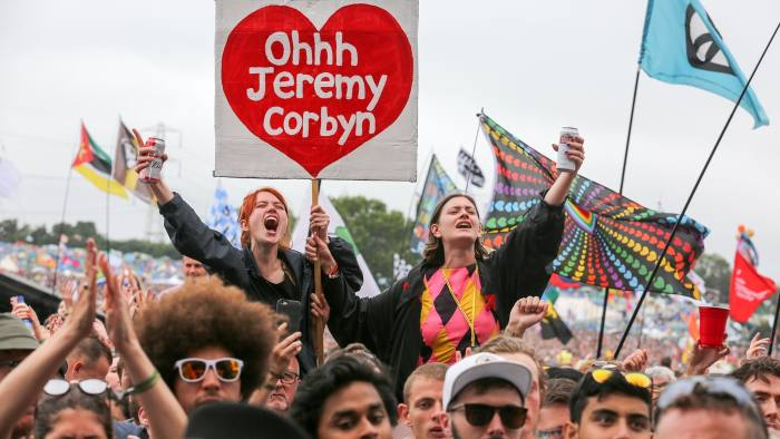 GLASTONBURY, ENGLAND - JUNE 24: Crowds cheer Labour Party leader Jeremy Corbyn address the crowd from the main stage a the Glastonbury Festival site at Worthy Farm in Pilton on June 24, 2017 near Glastonbury, England. Glastonbury Festival of Contemporary Performing Arts is the largest greenfield festival in the world. It was started by Michael Eavis in 1970 when several hundred hippies paid just £1, and now attracts more than 175,000 people. (Photo by Matt Cardy/Getty Images)