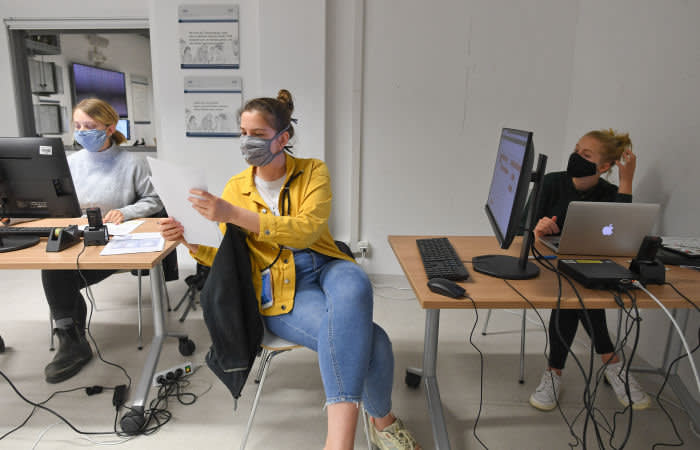 Students from the Technical University evaluate data from an ear sensor, designed to measure the biological values of COVID-19 patients in domestic isolation around the clock, as the spread of the coronavirus disease continues in Munich, Germany, May 6, 2020. Picture taken May 6, 2020. REUTERS/Andreas Gebert - UP1EG570O1R04