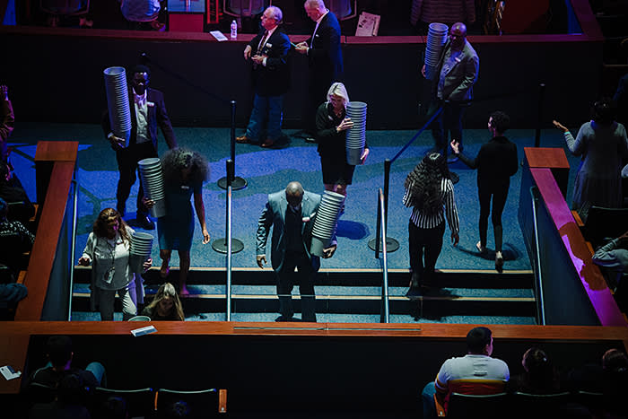 Church staff gather offering buckets – many congregants give a tenth of their income to Lakewood