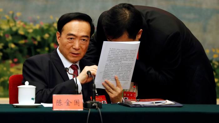 Xinjiang Uyghur Autonomous Region (XUAR) Party Secretary Chen Quanguo, attends a group discussion session on the second day of the 19th National Congress of the Communist Party of China at the Great Hall of the People in Beijing, China October 19, 2017. REUTERS/Tyrone Siu - RC1C8A378DF0