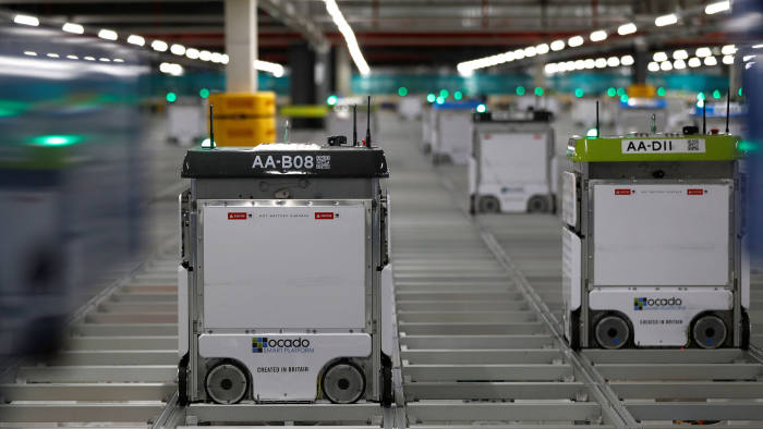 """Bots"" are seen on the grid of the ""smart platform"" at the Ocado CFC (Customer Fulfilment Centre) in Andover, Britain May 1, 2018. Picture taken May 1, 2018.  REUTERS/Peter Nicholls"