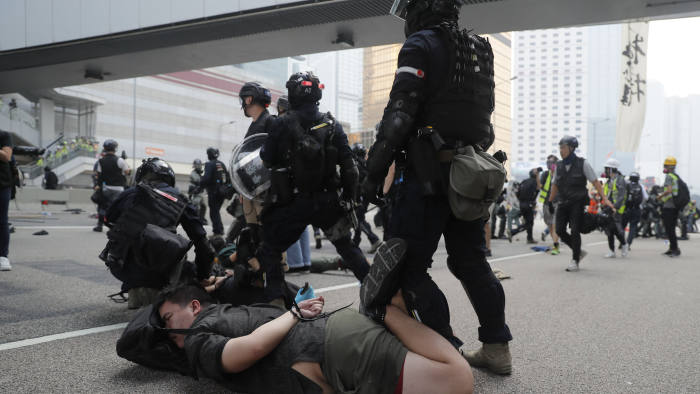 Police detain a protestor in Hong Kong, Sunday, Sept. 29, 2019. Riot police fired tear gas Sunday after a large crowd of protesters at a Hong Kong shopping district ignored warnings to disperse in a second straight day of clashes, sparking fears of more violence ahead of China's National Day. (AP Photo/Kin Cheung)