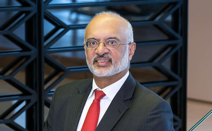 Piyush Gupta, chief executive officer of DBS Group Holdings Ltd., poses for a photograph following a Bloomberg Television interview in Singapore, on Monday, Feb. 18, 2019. DBS relied on lending to boost fourth-quarter profit as financial-market turbulence hit its trading, wealth and investment banking operations. Photographer: Ore Huiying/Bloomberg