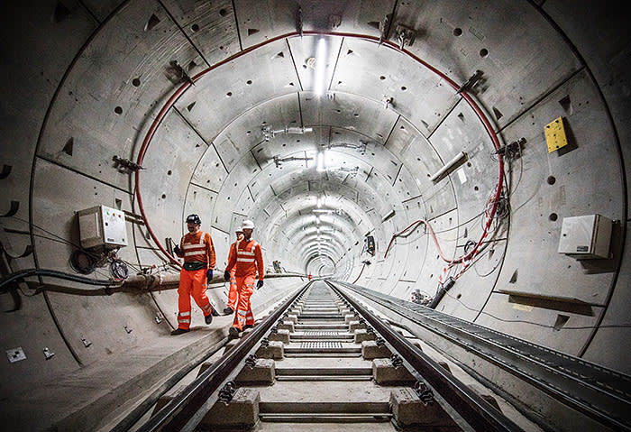 LONDON, ENGLAND - SEPTEMBER 14: Crossrail engineers inspect the completed track as the Crossrail project celebrates the completion of the Elizabeth line track, on September 14, 2017 in London, England. (Photo by John Phillips/Getty Images)