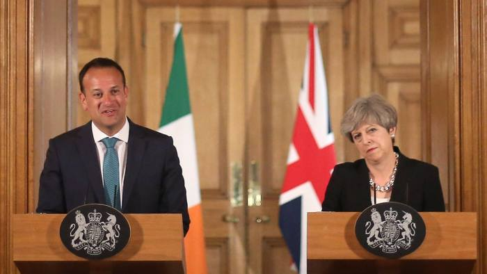 LONDON, ENGLAND - JUNE 19: Britain's Prime Minister Theresa May (R) and Irish Taoiseach Leo Varadkar shake hands at a joint press conference after talks at 10 Downing Street on June 19, 2017 in London, England. The new Irish Taoiseach said he had been reassured about a potential deal between the Conservative Party and the Democratic Unionist Party (DUP) after raising concerns about the deal with the Prime Minister. (Photo by Philip Toscano - WPA Pool/Getty Images)