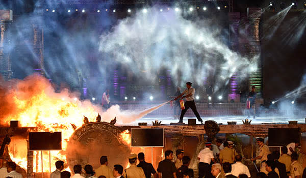 """MUMBAI, INDIA - FEBRUARY 14: A massive fire breaks out during a """"Make in India week"""" cultural programme at Maharashtra Night at Girgaum Chowpatty on February 14, 2016 in Mumbai, India. The fire broke out almost 10 minutes after Maharashtra CM Devendra Fadnavis delivered his speech at the event, during a lavani performance. The stage collapsed under the impact of the fire. However, no casualties were reported and the venue, the Girgaum Chowpatty area, was evacuated very soon. Around 16 fire tenders put out the fire in 10 minutes. No casualties have been reported yet. Prime Minister Modi had inaugurated the Make in India Week yesterday as a showcase event for the government's flagship manufacturing scheme. (Photo by Kunal Patil/Hindustan Times via Getty Images)"""