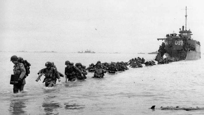 ** FILE ** U.S. reinforcements wade through the surf from a landing craft in the days following D-Day and the Allied invasion of Nazi-occupied France at Normandy in June 1944 during World War II. In Normandy there will be a international ceremony celebrating the 60th anniversary of D-Day on June 6, 2004. (AP Photo/Bert Brandt)