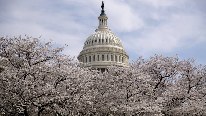 FILE- In this March 30, 2019, file photo the Dome of the U.S. Capitol Building is visible as cherry blossom trees bloom on the West Lawn in Washington. The number of people seeking U.S. unemployment benefits fell to its lowest level since late 1969, a sign that employers are holding onto their workers despite signs of a slowing economy. Weekly applications for jobless aid fell 10,000 to a seasonally adjusted 202,000, the Labor Department said Thursday, April 4. (AP Photo/Andrew Harnik, FIle)