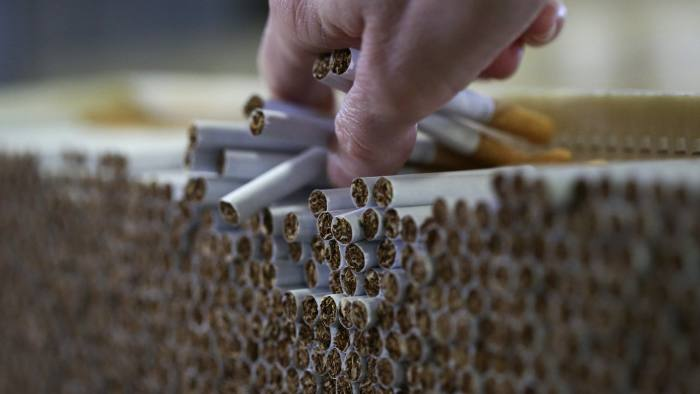 Imperial drops dividend target to bolster tobacco alternatives