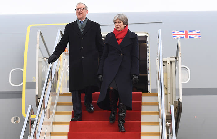 Prime Minister Theresa May and her husband, Philip arrive at Wuhan Tianhe International Airport in Hubei, China, ahead of a business delegation to encourage post-Brexit investment in the UK. PRESS ASSOCIATION Photo. Picture date: Wednesday January 31, 2018. See PA story POLITICS China. Photo credit should read: Stefan Rousseau/PA Wire