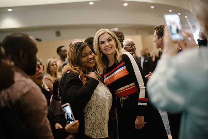 Victoria Osteen greets congregants in the church lobby – up to 50,000 people flock here every week to attend its services