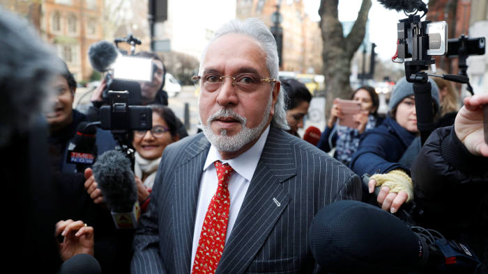 Vijay Mallya arrives at Westminster Magistrates Court to face an extradition request by India, in London, Britain, December 10, 2018. REUTERS/Peter Nicholls