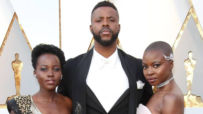 HOLLYWOOD, CA - MARCH 04: (L-R) Lupita Nyong'o, Winston Duke, and Danai Gurira attend the 90th Annual Academy Awards at Hollywood & Highland Center on March 4, 2018 in Hollywood, California. (Photo by Dan MacMedan/WireImage)