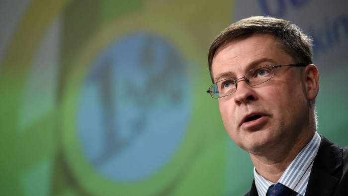 European Commission vice-president in charge the Euro, Social Dialogue, Financial Stability, Financial Services and Capital Markets Union Valdis Dombrovskis speaks during a press conference on deepening Europe's Economic and Monetary Union at the EU headquarters in Brussels, on June 12, 2019. (Photo by JOHN THYS / AFP) (Photo credit should read JOHN THYS/AFP via Getty Images)