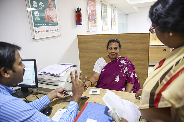 Customers are guided by Staff at the Koramangala branch of Ujjivan Bank in Bangalore, India.