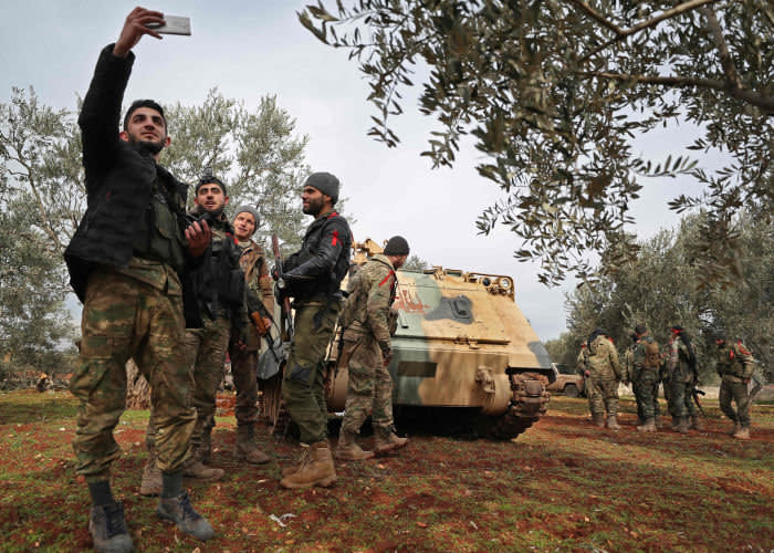 Turkish-backed Syrian fighters gather in the town of Sarmin, about 8 kilometres southeast of the city of Idlib in northwestern Syria on February 11, 2020. (Photo by Omar HAJ KADOUR / AFP) (Photo by OMAR HAJ KADOUR/AFP via Getty Images)