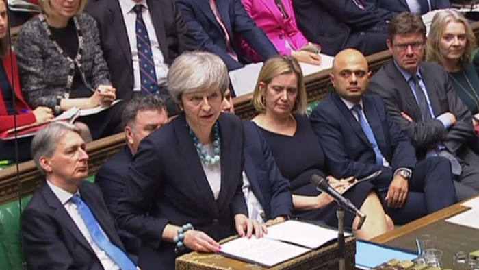"""A video grab from footage broadcast by the UK Parliament's Parliamentary Recording Unit (PRU) shows Britain's Prime Minister Theresa May making a statement in the House of Commons in London on December 10, 2018. - Theresa May told the house that the Brexit withdrawal bill will be deferred. (Photo by HO / various sources / AFP) / RESTRICTED TO EDITORIAL USE - NO USE FOR ENTERTAINMENT, SATIRICAL, ADVERTISING PURPOSES - MANDATORY CREDIT """" AFP PHOTO / PRU """"HO/AFP/Getty Images"""