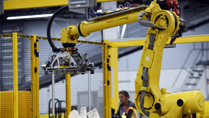 A robot prepares to pick up a tote containing product during the first public tour of the newest Amazon Robotics fulfillment center on April 12, 2019 in the Lake Nona community of Orlando, Florida. The over 855,000 square foot facility opened on August 26, 2018 and employs more than 1500 full-time associates who pick, pack, and ship customer orders with the assistance of hundreds of robots which can lift as much as 750 pounds and drive 5 feet per second. (Photo by Paul Hennessy/NurPhoto via Getty Images)