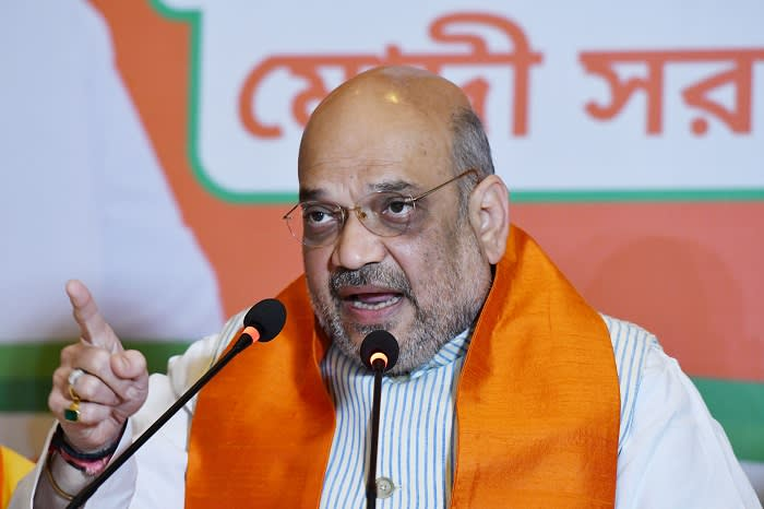 """Amit Shah , National President of BJP addressing a press conference on April 22,2019 in Kolkata,India. Amit Shah said, """"Sadhvi Pragya ko jhoothe case me fansaya gaya [Sadhvi Pragya was framed on a false case]."""" He said in fact questions should be asked on the Samjhauta blast case. """"The real question is where are the culprits of the Samjhauta blast? Who are they? West Bengal Chief Minister Mamata Banerjee should respond to all these questions,"""" Amit Shah said. Intensifying his attack on Mamata Banerjee, Amit Shah dared West Bengal chief minister to clarify her stand on Omar Abdullah's demand for a separate prime minister, Article 370 and Article 35A. """"The BJP is being called a terrorist organisation. I dare Mamata Banerjee to clarify her stand on Articles 370 and 35A,"""" he said. (Photo by Debajyoti Chakraborty/NurPhoto via Getty Images)"""