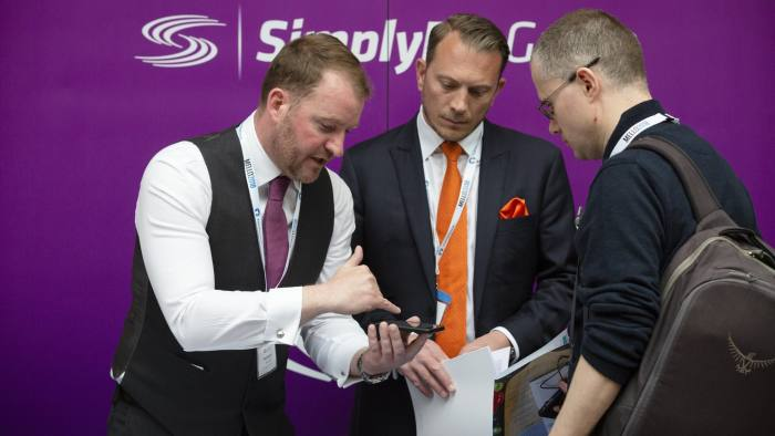 The Mello conference in Derby for small investors. Neil Stevens (left) and Matthew Timmins of the SimplyBiz Group on their stand.