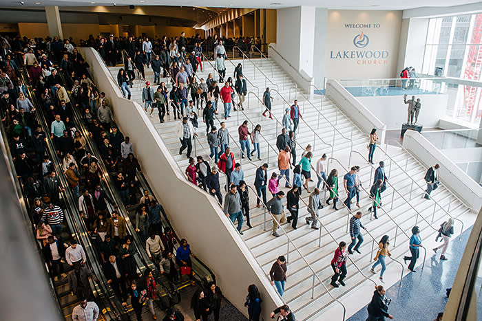 Congregants leaving Lakewood after a service – the church's income in 2017 was $89m but just one per cent of that was spent on charitable causes