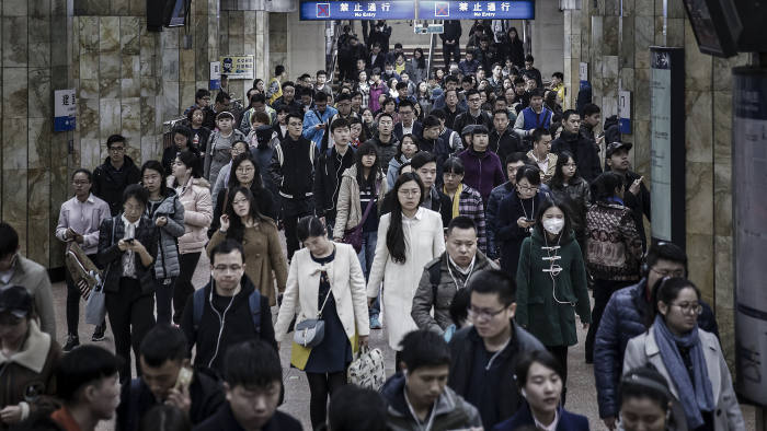 Commuters walk through a subway station in Beijing, China, on Tuesday, March 14, 2017. China has championed free trade and globalization, and while there have been issues with the process, the country is ready to work with other nations to improve the international governance system, Premier Li Keqiang said at a press conference in Beijing after the close of the annual National People's Congress on March 15. Photographer: Qilai Shen/Bloomberg