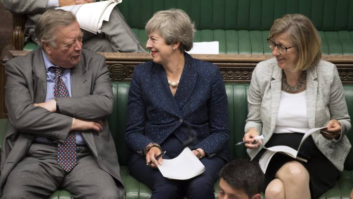 Former prime minister Theresa May (centre) smiling as she sits next to father of the house, Conservative MP Kenneth Clark (L) in the House of Commons, London, Tuesday Sept. 3, 2019.