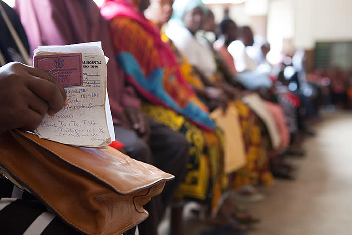 FF81X6 A line of waiting patients in the reception area of St. Francis Hospital, Ifakara.