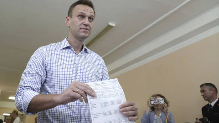 Russian opposition activist Alexei Navalny casts his vote in Sunday's city council election in Moscow