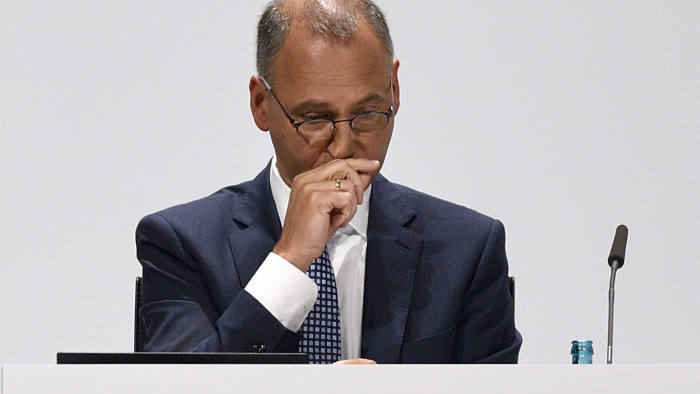In this Friday, April 26, 2019 photo CEO Werner Baumann attends the annual general meeting of Bayer AG in Bonn, Germany, Friday, April 26, 2019. Following the record acquisition of U.S. biotech and seed company Monsanto, Bayer lost around half of its value in market capitalization. For the first time shareholders did not approve the actions of the Management Board. (AP Photo/Martin Meissner)