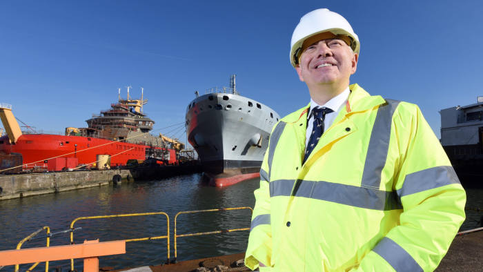 Tony Graham, CEO of Cammell Laird shipyard, Birkenhead with the under-construction Sir David Attenborough and the Royal Navy support vessel Tidespring