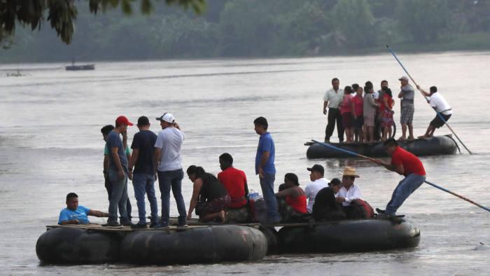 Migrants on a raft cross the Suchiate river on the Guatemala – Mexico, near Ciudad Hidalgo, Mexico, Saturday June 8, 2019. (AP Photo/Marco Ugarte)