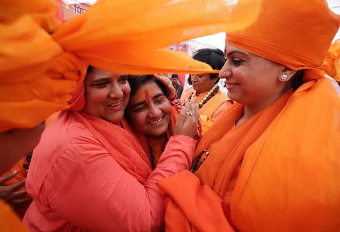 Sadhvi Pragya Singh Thakur (C) is welcomed during a rally before filing her nomination for the Bharatiya Janata Party (BJP) in the parliamentary elections in Bhopal on April 23, 2019. - Some 190 million voters in 15 states are eligible to take part in the polls on the third of seven days of voting in the world's biggest election. (Photo by GAGAN NAYAR / AFP) (Photo credit should read GAGAN NAYAR/AFP/Getty Images)