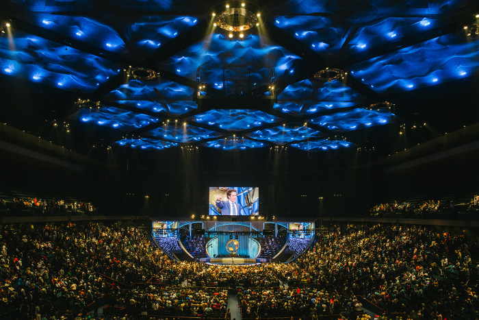 A Joel Osteen service at Lakewood Church in Houston, Texas, last month: 'Had he chosen the life of a preacher, Trump would surely have designed his church like Lakewood — with its curved stage, glitzy video screens and rotating golden globe'